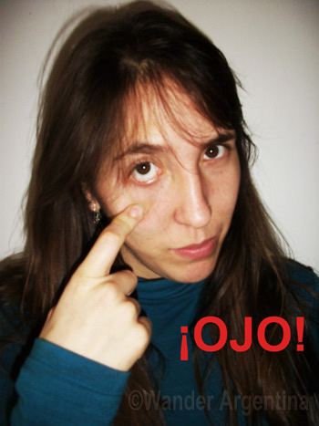 The gestulation for 'OJO!', a common expression in Argentina to warn someone
