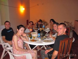 A group of young people sharing dinner in a shared house or casa compartida in Buenos Aires