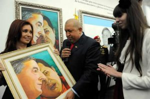 Hugo Chavez and Cristina Kirchner view a painting of the faces of Nestor Kirchner and Chavez