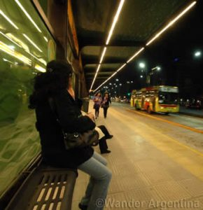 A woman waits for the bus at a new Metrobus stop on 9 de Julio