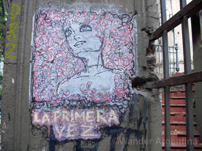 Graffiti in Argentina of a woman that says 'la primera vez'