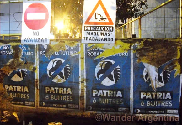 Posters on the streets of Buenos Aires say 'Homeland or Vultures'