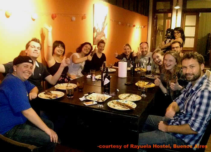 An international group around the dinner table at Rayuela Hostel in Buenos AIres, Argentina